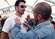 UNITED KINGDOM-LONDON. Louis Spence signs shirts  at Skyfest 2010. 17/07/2010. STEPHEN SIMPSON...