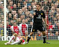 Photo: Scott Heavey.Digitalsport<br /> Arseanl v Manchester United. FA Barclaycard Premiership. 28/03/2004.<br /> Gary Neville accuses Jose Reyes of diving