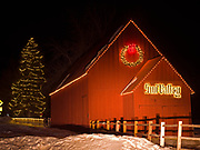 Winter view of historic red barn built in the early 1880s to service ore wagons, Sun Valley, Idaho