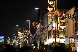 "© Licensed to London News Pictures. 01/11/2015. Leicester, UK. More than 35,000 people were estimated to have attended the annual Diwali ight switch-on which took place along the named ""Golden Mile"" in Belgrave Road, Leicester. Pictured, the Diwali lights on the Belgrave road. Photo credit : Dave Warren/LNP"