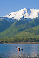 Kayaking on Hungry Horse Reservoir with Great Northern Mountain in background in the Flathead National Forest of Montana model released