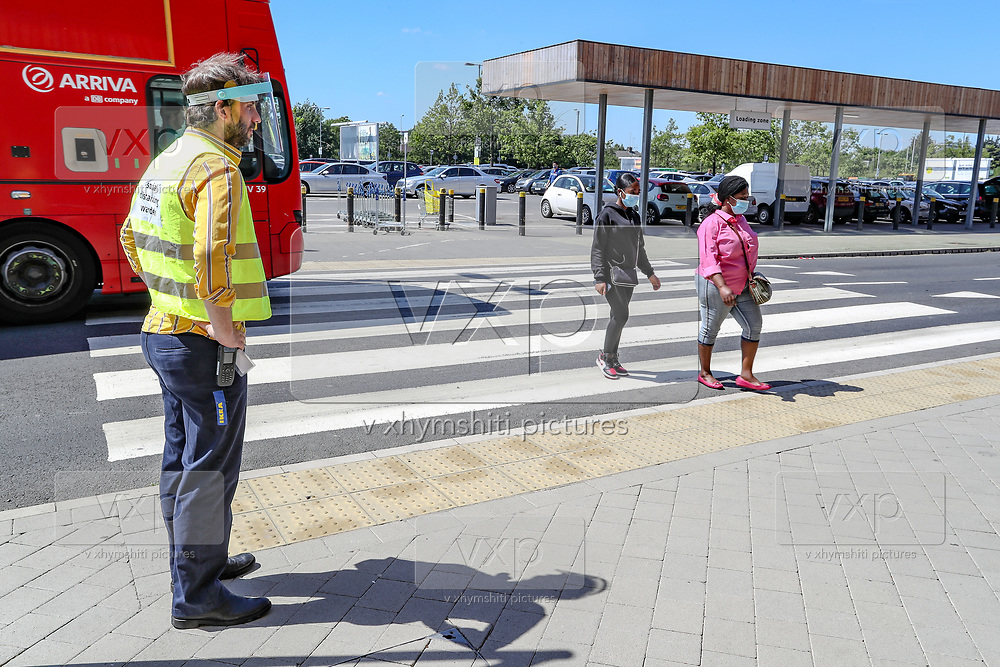 IKEA personnel wearing personal protective equipment, welcome customers queuing at the IKEA Greenwich store in South London as it reopens to the public following the introduction of measures to bring England out of lockdown, Monday, Jun 1, 2020. (Photo/ Vudi Xhymshiti)