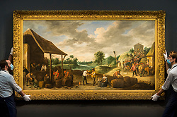 """© Licensed to London News Pictures. 07/12/2020. LONDON, UK. Technicians present """"The Wine Harvest"""" by David Teniers The Younger (Est. £3-5m). Preview of Sotheby's upcoming Christmas Sale Series of Old Masters and Treasures - paintings and objects spanning 800 Years.  The sales will be at Sotheby's New Bond Street gallery.  Photo credit: Stephen Chung/LNP"""
