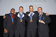 Team GB's four-man bobsleigh team receive their bronze medal from the Sochi 2014 Olympic Winter Games at the Team GB Ball on Thursday 21 November 2019 in London in the United Kingdom. The GB 1 crew, consisting of Joel Fearon, Stuart Benson, Bruce Tasker and John Jackson, finished the competition in fifth place but following the disqualification of two crews have been promoted into the bronze medal position. Athletes from both Russia 1, gold medallists, and Russia 2, fourth, were found to have committed doping violations following thorough re-analysis of samples taken during the Games.
