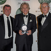 Derek Bell (M) recieves the Sport car award winner Henri for Pescarolo The Motor Sport Hall of Fame will return to the spectacular Royal Automobile Club at Woodcote Park, Surrey, London, UK. 4 June 2018.