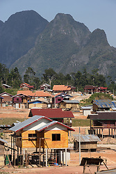New housing construction underway in the relocation village of Ban Tasala, Bolikhamsay Province, Lao PDR