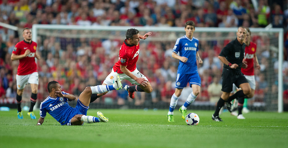 Manchester United's Robin van Persie is fouled by Chelsea's Ashley Cole<br /> <br /> Photo by Stephen White/CameraSport<br /> <br /> Football - Barclays Premiership - Manchester United v Chelsea - Monday 26th August 2013 - Old Trafford - Manchester<br /> <br /> © CameraSport - 43 Linden Ave. Countesthorpe. Leicester. England. LE8 5PG - Tel: +44 (0) 116 277 4147 - admin@camerasport.com - www.camerasport.com