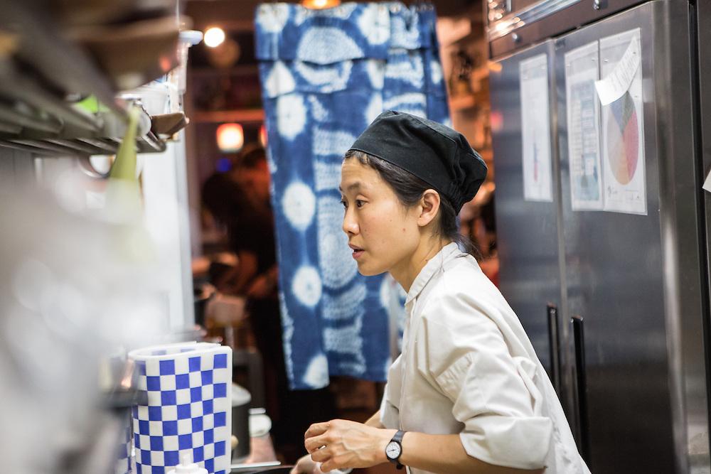 Brooklyn, NY - 26 April 2014. Chef Haegeen Kim in the kitchen at Dotory, a Korean restaurant on Broadway in Brooklyn's Williamsburg neighborhood.