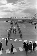 President John F. Kennedy arrives at Dublin Airport. Kennedy inspects the Guard of Honour as he steps from the plane.<br /> 26.06.1963