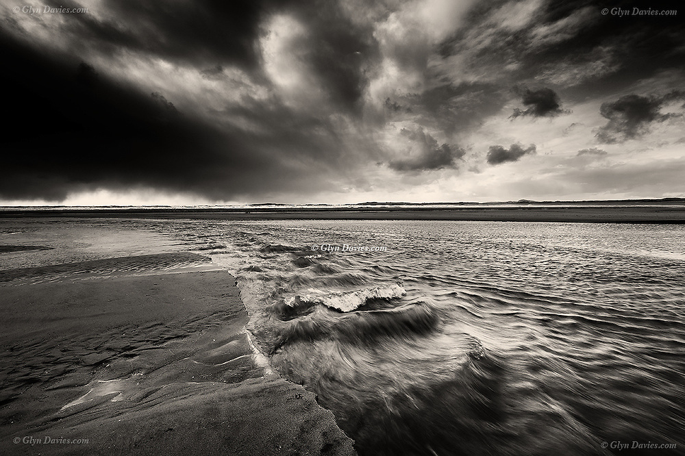 Brief sunshine over Rhosneigr gave way to black clouds and sleet moving in from the North over the Irish Sea.