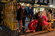 As Prime Minister Boris Johnson announces a second Coronavirus nationwide lockdown during the second wave of the pandemic, fancy dress party-goers celebrate Halloween in Soho, on 31st October 2020, in London, England. Small business such as bars and restaurants will again have to close except for takeaways from Thursday, and for a period of one month.