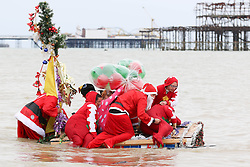 """© Licensed to London News Pictures. 07/07/2014. Brighton, UK. Participant of the Charitable race """"paddle something unusual"""" take to the water. South Coast recovers today with temperatures around 24C after a day with rain and clouds on Saturday. Photo Credit: Hugo Michiels/LNP"""