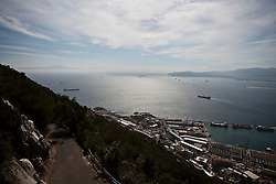The harbour and Bay of Gibraltar looking south with the coast of Africa on left. Photographs from the top of the Rock of Gibraltar. Images of Gibraltar, the British overseas territory located on the southern end of the Iberian Peninsula at the entrance of the Mediterranean.