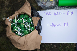 © Licensed to London News Pictures. 23/02/2018. London, UK. Hash lollipops are displayed for sale outside Parliament during a demonstration in support of cannabis for medicinal use - as MPs debate it's use in The House of Commons. Photo credit: Peter Macdiarmid/LNP