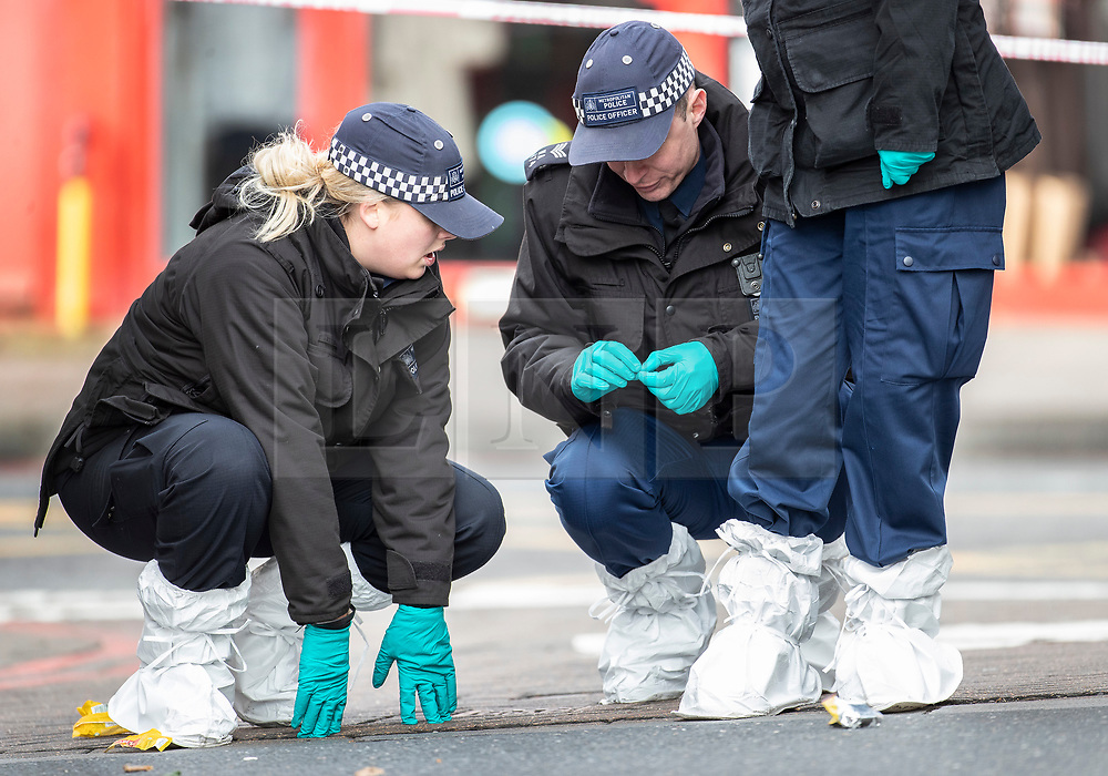 © Licensed to London News Pictures. 03/02/2020. London, UK. A police search team gathers evidence on Streatham High Road the day after a terrorist stabbed two people before being shot dead by police. Sudesh Amman, who was released from prison recently for terror offences, was under active police surveillance at the time of the attack - which police think was an Islamist-related terrorist incident. Photo credit: Peter Macdiarmid/LNP