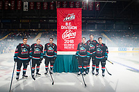 KELOWNA, CANADA - SEPTEMBER 22:  Leif Mattson #28, Kyle Topping #24, Erik Gardiner #11, Jack Cowell #8, Braydyn Chizen #22 and Conner Bruggen-Cate #20 of the Kelowna Rockets hang the BC Division Title banner from the 2018 regular season at their home opener against the Kamloops Blazers on September 22, 2018 at Prospera Place in Kelowna, British Columbia, Canada.  (Photo by Marissa Baecker/Shoot the Breeze)  *** Local Caption ***