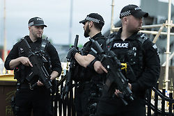 © Licensed to London News Pictures . 27/05/2017 . Manchester , UK . Armed police outside the stadium during the Courteeners' set . Manchester music line up , featuring Courteeners , Charlatans , Blossoms and Cabbage , at the Emirates Old Trafford Stadium . Photo credit : Joel Goodman/LNP