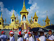 13 DECEMBER 2017 - BANGKOK, THAILAND:  School children on the south side of the Royal Crematorium on Sanam Luang in Bangkok. The crematorium was used for the funeral of Bhumibol Adulyadej, the Late King of Thailand. He was cremated on 26 October 2017. The crematorium is open to visitors until 31 December 2017. It will be torn down early in 2018. More than 3 million people have visited the crematorium since it opened to the public after the cremation of the King.    PHOTO BY JACK KURTZ
