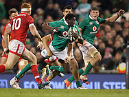 Niyi Adeolokun of Ireland makes a break during the 2016 Guinness Series  autumn international rugby match, Ireland v Canada at the Aviva Stadium in Dublin, Ireland on Saturday 12th November 2016.<br /> pic by  John Halas, Andrew Orchard sports photography.