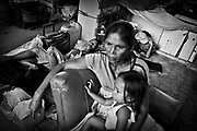 MARIKINA, PHILLIPPINES - NOVEMBER 2009: Woman and her child in evacuations center. Up to 200 families have been living in this former basket ball arena, now an evacuations center, since the typhoons causes flooding and did living in their houses impossible. Nobody nows about the future.(Photo by Carsten Snejbjerg/Edit byGetty Images)