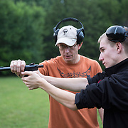 A retired marine Range Master teaches  gun safety and firearms technique.