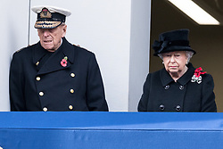 © Licensed to London News Pictures. 12/11/2017. London, UK. The DUKE OF EDINBURGH and HRH QUEEN ELIZABETH II<br /> attends a Remembrance Day Ceremony at the Cenotaph war memorial in London, United Kingdom, on November 13, 2016 . Thousands of people honour the war dead by gathering at the iconic memorial to lay wreaths and observe two minutes silence. Photo credit: Ray Tang/LNP