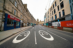 Edinburgh, Scotland, UK. 29 March, 2020. Life in Edinburgh on the first Sunday of the Coronavirus lockdown. Streets deserted, shops and restaurants closed, very little traffic on streets and reduced public transport. Pictured; Leith Walk. Iain Masterton/Alamy Live News