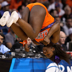 Mar 17, 2011; Tampa, FL, USA; A Clemson Tigers cheerleader performs a flip during the first half of the second round of the 2011 NCAA men's basketball tournament against the West Virginia Mountaineers at the St. Pete Times Forum.  Mandatory Credit: Derick E. Hingle