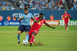 August 22, 2018 - Bronx, New York, United States - New York City midfielder ISMAEL TAJOURI (29) fights for the ball abasing New York Red Bulls defender KEMAR LAWRENCE (92) during a regular season match at Yankee Stadium in Bronx, NY.  New York City FC tie the New York Red Bulls 1 to 1 (Credit Image: © Mark Smith via ZUMA Wire)