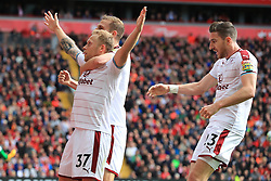 Burnley's Scott Arfield (left) celebrates scoring his side's first goal of the game during the Premier League match at Anfield, Liverpool.