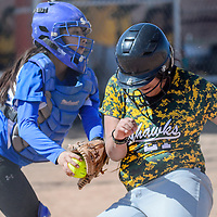 Zuni Thunderbird catcher Alanee Esalio (6) tags Newcomb Skyhawk Holly Ben (21) out at home Thursday at Tohatchi High School.