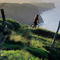 Hawaii, Molokai, Mountain Biking Mimo Pasture, above seacliffs