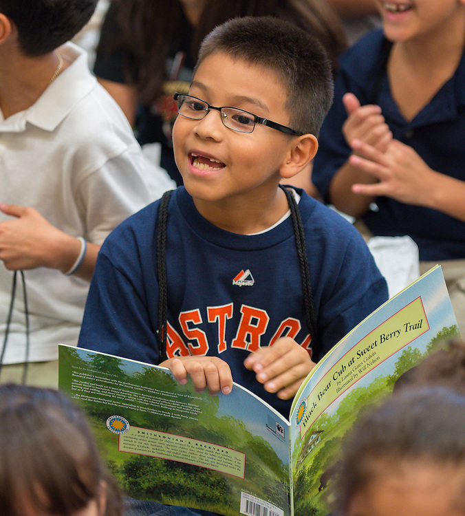 Houston Astros catch Jason Castro and his wife, Maris, hand out books and prizes to students at Moreno ES for their participation in the Millionaire Club summer reading program, September 12, 2013.