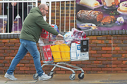 © Licensed to London News Pictures. 01/11/2020.  <br /> Locksbottom, UK. A man pushing a full trolley. After the second lockdown announcement yesterday by Prime Minister Boris Johnson, people are filling their shopping trolleys with essential items at Sainsbury's in Locksbottom in the borough of Bromley, South East London. Photo credit:Grant Falvey/LNP