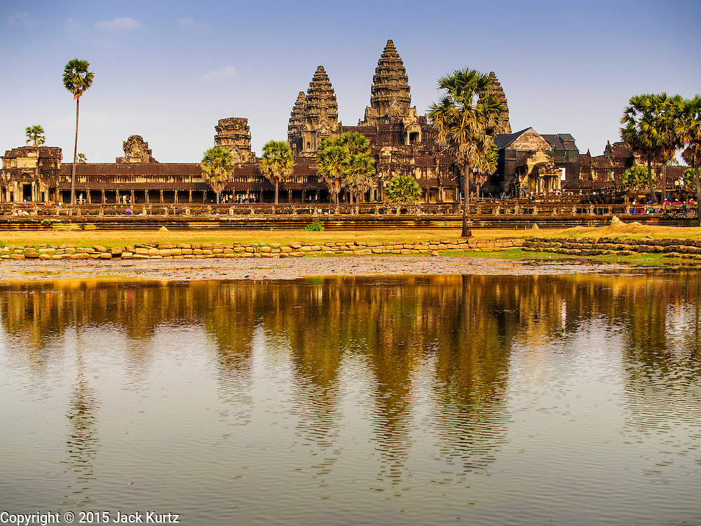 """13 MARCH 2015 - SIEM REAP, SIEM REAP, CAMBODIA:  Angkor Wat, the main temple for which the Angkor Wat complex is named after. The area known as """"Angkor Wat"""" is a sprawling collection of archeological ruins and temples. The area was developed by ancient Khmer (Cambodian) Kings starting as early as 1150 CE and renovated and expanded around 1180CE by Jayavarman VII. Angkor Wat is now considered the seventh wonder of the world and is Cambodia's most important tourist attraction.   PHOTO BY JACK KURTZ"""