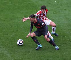 19 August 2017  : Premier League Football : Stoke City v Arsenal: Mesut Ozil of Arsenal is closely marked by Joe Allen of Stoke:<br />  Photo: Mark Leech