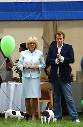HRH The DUCHESS OF CORNWALL and her son TOM PARKER BOWLES at the 3rd annual Macmillan Dog Day in aid of Macmillan Cancer Relief held at Royal Hospital Chelsea, London SW3 on 5th July 2005.<br />