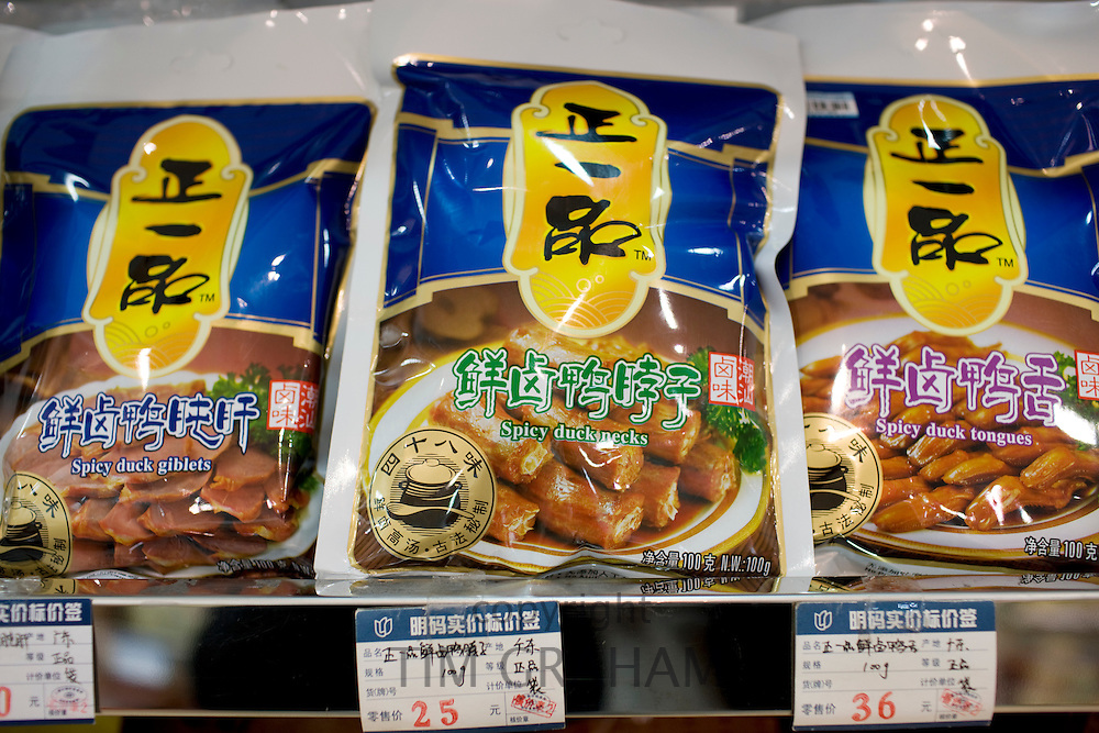 Bags of spicy duck necks, giblets and tongues in souvenir shop, Shanghai, China