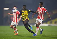 Football - 2020 / 2021 Sky bet Championship - Watford vs Stoke City - Vicarage Road<br /> <br /> Watford's Ismaïla Sarr holds off the challenge from Stoke City's John Obi Mikel and Jordan Thompson.<br /> <br /> COLORSPORT/ASHLEY WESTERN
