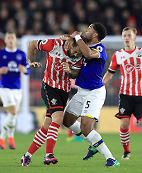 Southampton's Charlie Austin (left) and Everton's Ashley Williams (right) battle for the ball during the Premier League match at St Mary's Stadium, Southampton.