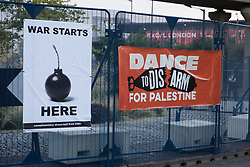Banners are pictured during Stop The Arms Fair protests outside ExCeL London as preparations for the DSEI 2021 arms fair continue on 8th September 2021 in London, United Kingdom. The third day of week-long Stop The Arms Fair protests outside the venue for one of the world's largest arms fairs was themed around demilitarising education.