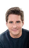 one  man mature handsome portrait blue eyes smiling portrait studio white background