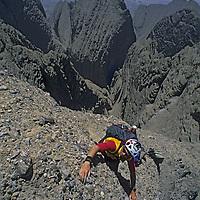 Sam Lightner (MR) climbs huge dangerous crumbling conglomerate rock on huge Shipton's Arch in the arid Kara Tagh Mountains near Kashgar & the Taklimakan Desert. Nancy Feagin belays.