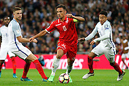 England Midfielder Jesse Lingard looks to close down Malta Forward Andre Schembri during the FIFA World Cup Qualifier match between England and Malta at Wembley Stadium, London, England on 8 October 2016. Photo by Andy Walter.