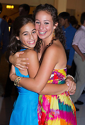 two sisters at a Bat Mitzvah hugging