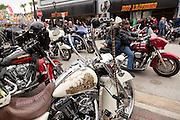 Leather clad bikers ride down Main Street past custom painted Harley-Davidson bikes during the 74th Annual Daytona Bike Week March 7, 2015 in Daytona Beach, Florida.