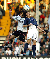 Fotball<br /> Premier League England 2004/2005<br /> Foto: SBI/Digitalsport<br /> NORWAY ONLY<br /> <br /> 30.10.2004<br /> Fulham v Tottenham Hotspur<br /> <br /> Carlos Bocanegra of Fulham goes up for an aerial ball with Simon Davies of Tottenham