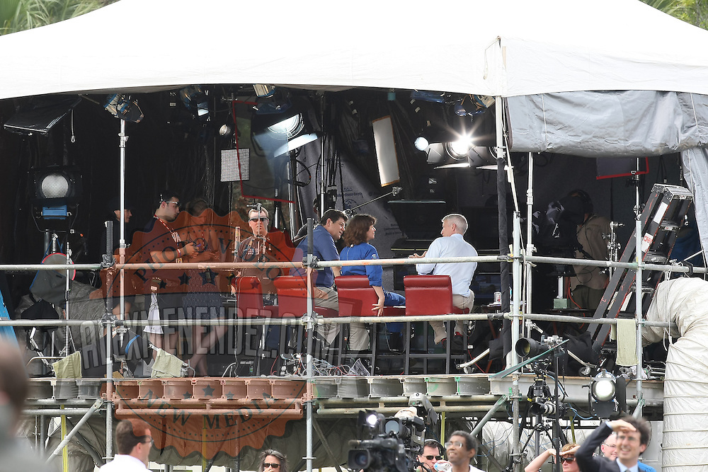 CNN Anchor Anderson Cooper speaks while Space Shuttle Atlantis lifts off from the Kennedy Space Center Friday, July 8, 2011, in Cape Canaveral, Fla. Shuttle Atlantis is the 135th and final space shuttle launch for NASA..  (AP Photo/Alex Menendez)