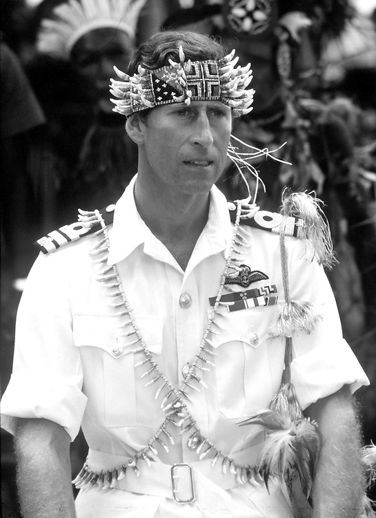 The Prince of Wales in Papua new Guinea in 1975 wearing traditional tribal gifts. Photographed by Terry Fincher