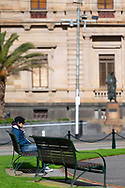 A woman sits near Gordan Fountain with Treasury Building in the background during COVID-19. A further 238 Coronavirus cases have been discovered overnight, bringing Victoria's active cases to over 2000, speculation is rising that almost all of Victoria's current cases stem from the Andrews Government botched hotel quarantine scheme as well as the Black Lives Matter protest.  Premier Daniel Andrews warns that Victoria may go to Stage 4 lockdown if these high numbers continue. (Photo be Dave Hewison/ Speed Media)